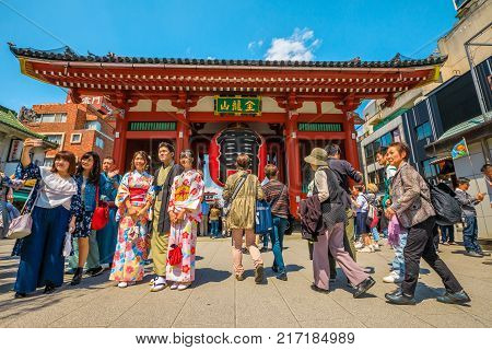 Tokyo, Japan - April 19, 2017: people and women in traditional japanese kimonos posing for selfie to Kaminarimon Gate of Senso-ji Temple in Asakusa area. Sensoji is the oldest temple in Tokyo.