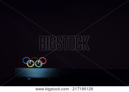 MONTREAL CANADA - DECEMBER 24 2016: Olympic symbol (also known as Olympic Rings) seen on the Montreal olympic Committee building lit during a dark night. Montreal became an olympic city with the 1976 Summer Olympic Games