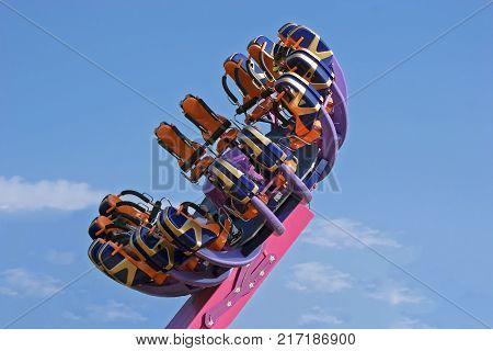 children's rides at the amusement Park on blue sky background