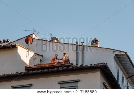Florence, Italy - August 23, 2016: Unidentified couple dinning in a roof in Florence, Tuscany, Italy Europe