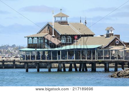 SAN DIEGO, CALIFORNIA, JUNE 9: Seaport Village on June 9, 2017, in San Diego, California. The Pier Cafe restaurant in Seaport Village popular with locals and tourists alike.