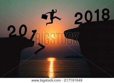 Businessman jump between 2017 and 2018 years.To success