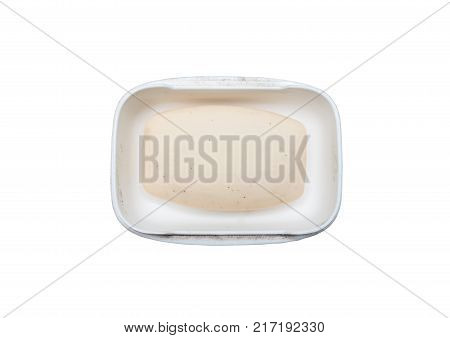 Old rustic soap in the dirty white plastic dish on the white background.