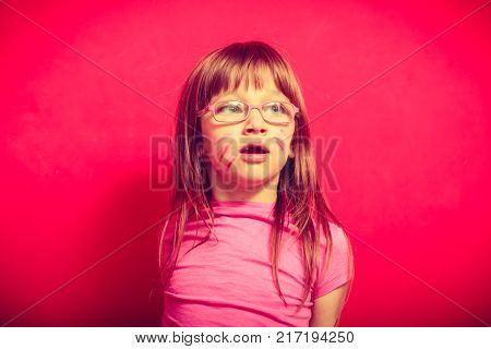 Childhood childcare foolin around concept. Little toddler girl wearing eyeglasses making funny face
