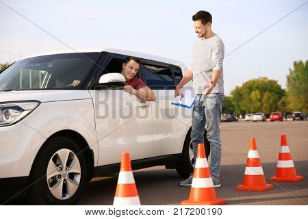 Young man passing driving license exam