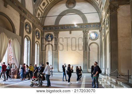 Florence Italy - April 03 2017: Interior of Pazzi Chapel by Filippo Brunelleschi located in the cloister of the Basilica Santa Croce in Florence Italy