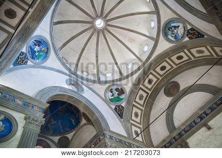 Florence Italy - April 03 2017: Ceiling of Pazzi Chapel by Filippo Brunelleschi located in the cloister of the Basilica Santa Croce in Florence Italy