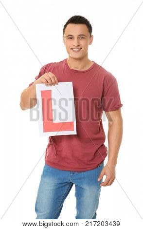 Young man holding learner driver sign on white background