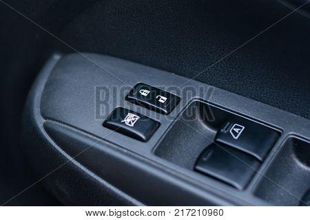 Car door interior armrest with window control panel door lock button