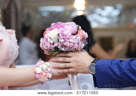 Man putting engagement ring on fiancee finger, young couple is getting engaged, engagement ring on woman hand