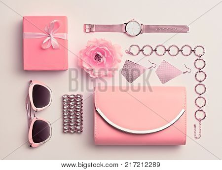 Fashion. Woman Pink Accessories Set. Flat lay. Trendy Rose Gold Watch, Summer Sunglasses, Glamour fashion Clutch. Flower. Luxury Stylish Spring lady. Pastel Color