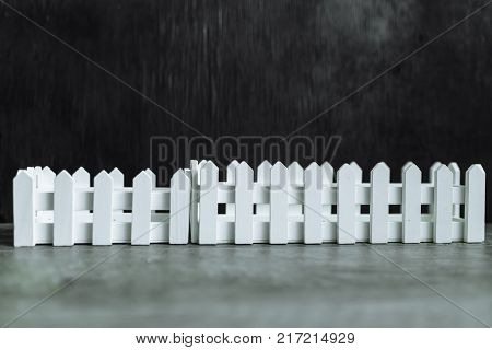 Black background. A white picket fence. Background to insert text