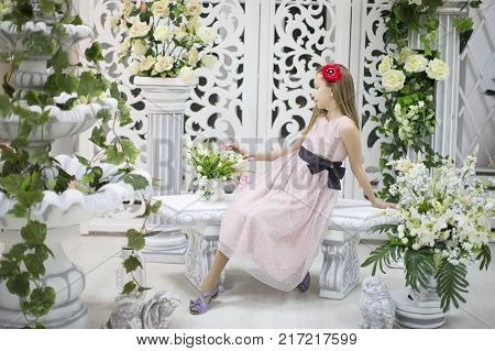Romantic teen girl in beautiful environment. Dreamer. Little girl dreams of love
