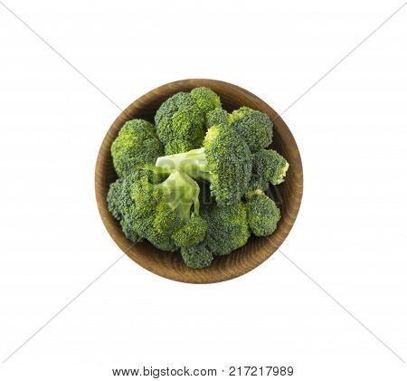 Top view. Broccoli in wooden bowl. Broccoli isolated on white. Broccoli with copy space for text. Broccoli on white background.