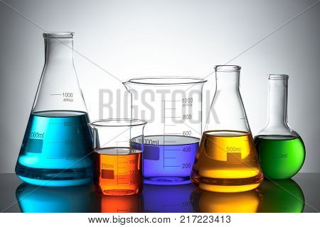 Laboratory glassware set with color liquid and reflection poster