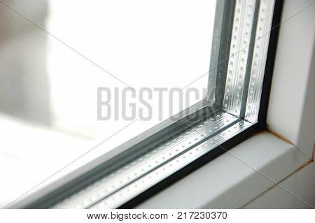 Plastic double glaze white window closeup on nature background.