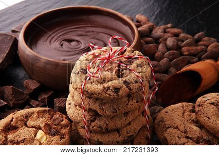 Chocolate cookies on dark table. Chocolate chip cookies.