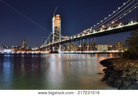 View of the Manhattan Bridge at night.
