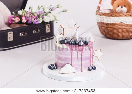 French mousse cake covered with lilac glaze on table. Purple modern European dessert with fruit decoration poster