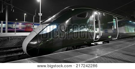 Modern Intercity trains at a UK station at night
