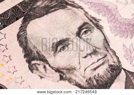Super macro. Portrait of President Lincoln on a five-dollar bill.