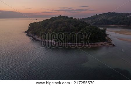 stunning sunset at Kala island. Layan beach and Bangtoa beach is the same beach the left side is Bangtoa beach the right side is Layan beach in the end of Layan beach has Kala island