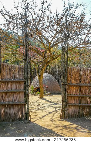 hut seen from the fence Swazi tribe in Swaziland