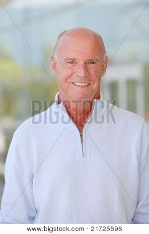 Portrait of handsome senior man with blue sweater