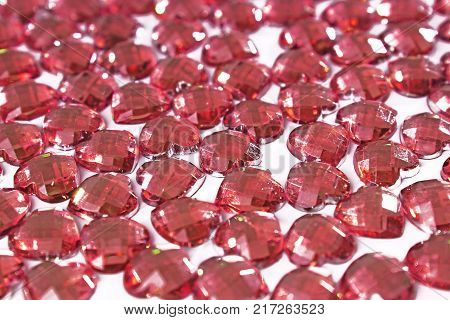 Red Rhinestone background. Heart shape texture as backdrop isolated white studio photo. Bling rhinestone crystal pattern. Rhinestones crystals as background. Red.