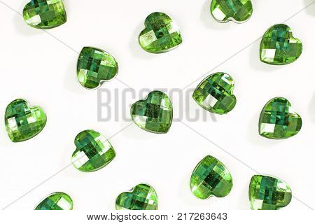 Green Rhinestone background. Heart shape texture as backdrop isolated white studio photo. Bling rhinestone crystal pattern. Rhinestones crystals as background. green.