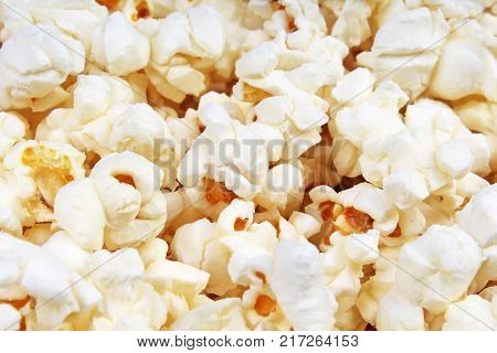 Scattered salted popcorn, food texture background. Fastfood popular during a movie in a cinema. Popcorn texture. Popcorns.