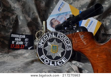 ILLUSTRATIVE EDITORIAL.Chevron of Ukrainian Police.Back -  Political program of Mikhail Saakashvili  and Sticker Pork - go away (UKR).Protests against president Poroshenko.Kiev,Ukraine December 7.2017