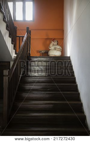 Brown wooden staircase with window light stock photo