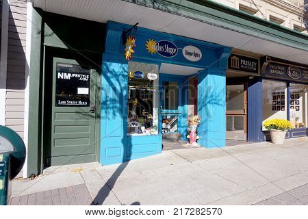 PETOSKEY, MICHIGAN / UNITED STATES - OCTOBER 18, 2017: One may buy glasses in the Sunglass Shoppe, in the historic building of the former Hollywood Theater, on Lake Street in downtown Petoskey.