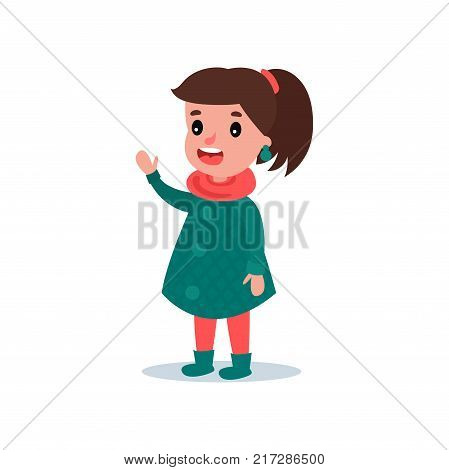Portrait of happy child in autumn green checkered coat, boots, red scarf and pants. Cartoon girl character standing, waving hand and saying hello. Fashion little kid. Isolated flat vector design.
