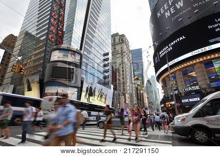 NEW YORK CITY USA - AUG. 26 : Traffic and people on street in Manhattan on August 26 2017 in New York City NY. Manhattan is the most densely populated borough of New York City.
