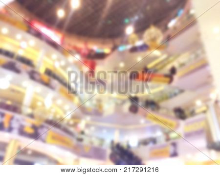 Blurred bokeh background with people in shopping mall with bokeh light. Blur image people in shopping mall. Shopping mall centre blur background with lights