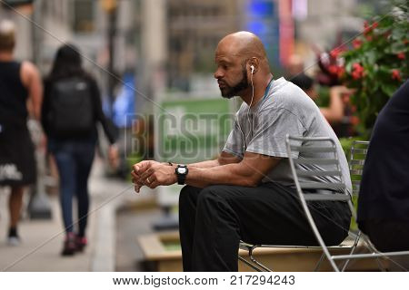 NEW YORK CITY - AUG. 25: Unidentified people on the Times Square in Manhattan on August 25 2017 in New York City NY. Times Square is a major tourist destination and entertainment center.