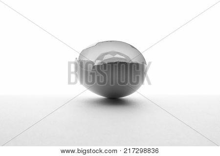 Idea concept. The idea ripe . Idea born. Cracked shell egg and crystal on white bachground