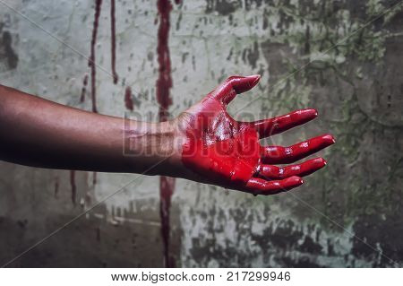 Horror Scene with Bloody Hand in an abandoned house them.The story about the murder.Background operators in Halloween festivities.
