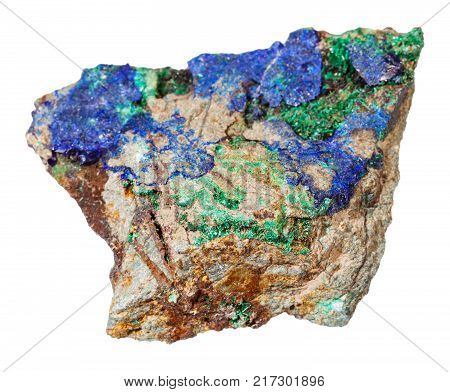 macro shooting of natural mineral rock specimen - blue Azurite and green Malachite on raw stone isolated on white background from Ural Mountains, Russia