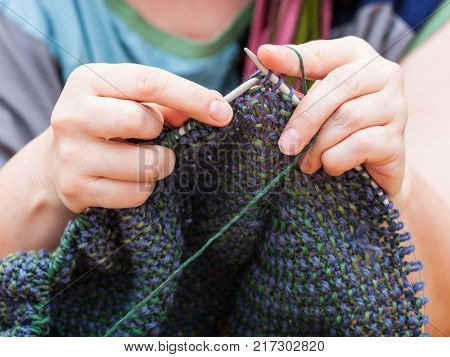 Knitter Knits Pullover From Wool