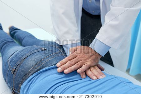 Chiropractor doing pushing motion to adjust back