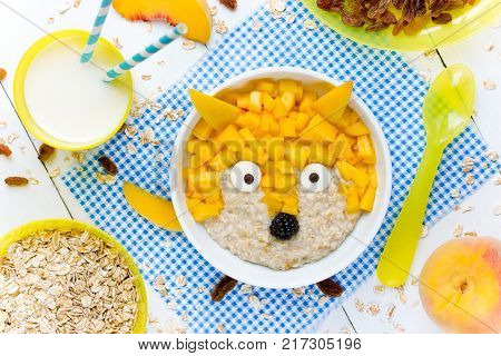 Creative idea for kids breakfast oatmeal healthy bowl with fruit shaped funny fox