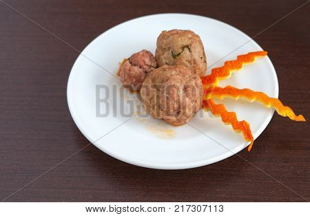 plate of meatballs on the brown table