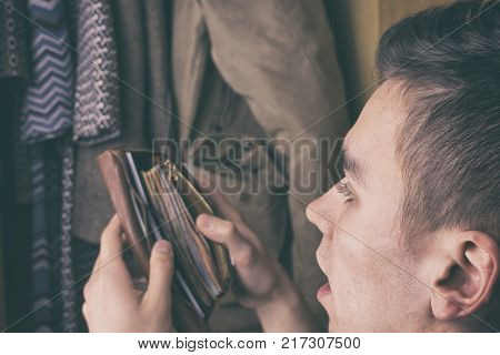 A young man steals money from wallet