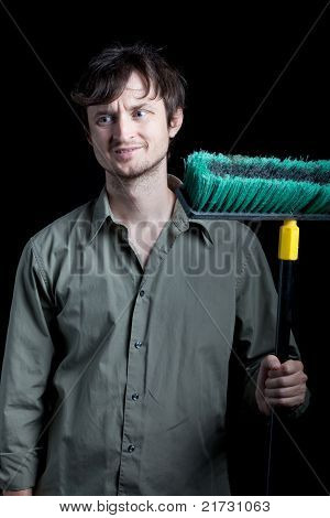 unhappy Janitor with push broom