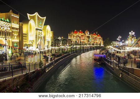 Dubai UAE - December 2017: View from bridge to pavilion India Morocco KSA. Night view. Global Village Dubai UAE. World's largest tourism leisure and entertainment project