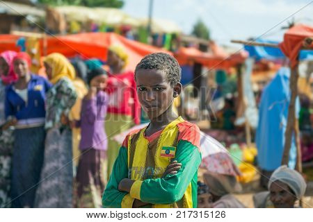 ADDIS ABBABA, ETHIOPIA - MAY 1, 2015 : Young ethiopian boy at a popular local market near Addis Abbaba.