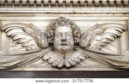 LUCCA, ITALY - JUNE 03: Angel on the portal of Santa Maria Corteorlandini church in Lucca, Tuscany, Italy on June 03, 2017.